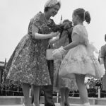 A young girl presents The Queen with flowers, Morrisburg